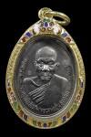 เหรียญรุ่นแรกหลวงพ่ออุ้น วัดตาลกง เพชรบุรี เนื้ออัลปาก้า  ปี2540 มีจาร พร้อมเลี่ยมทองลงยา